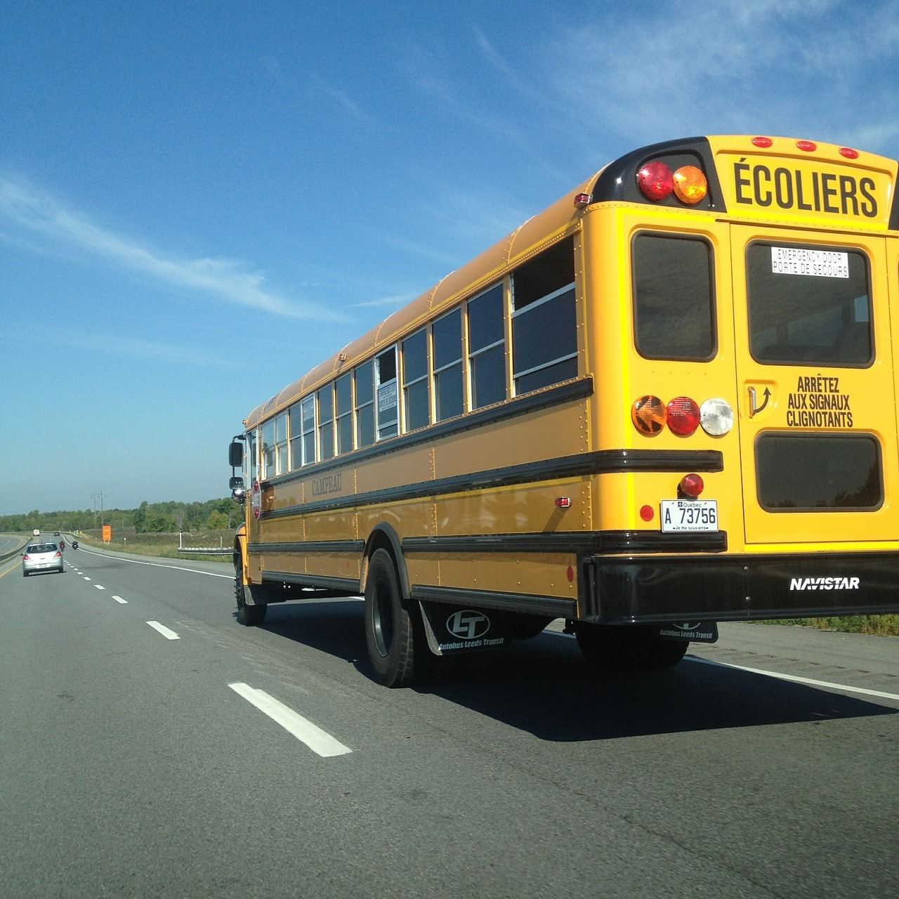 School bus on the road. Motorist, be careful.